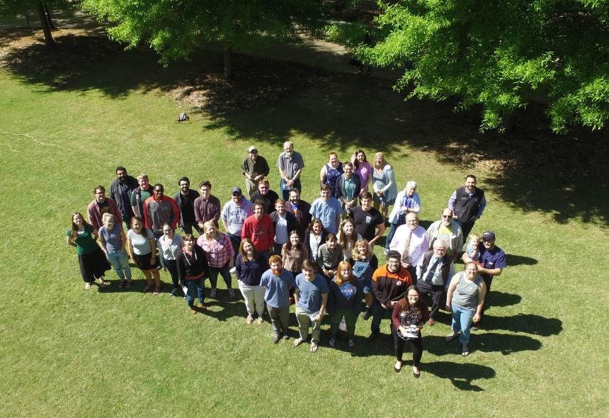 A bird's eye view of Geology faculty, staff and students stand on the quad. Taken by Melanie Callihan with an unmanned aerial system (UAS).