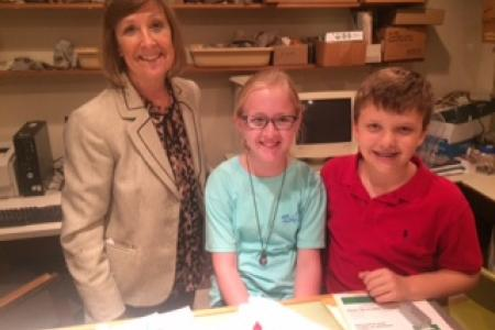 third graders Zoey Martin and Sam Seward visit Marta's office